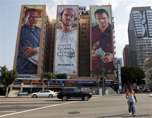 "FILE - This Sept. 10, 2013 file photo shows the ""Grand Theft Auto V "" billboard at Figueroa Hotel in Los Angeles. Target Australia said Wednesday, Dec. 3, 2014, it is removing ""Grand Theft Auto V"" from store shelves after an online petition signed by more than 40,000 individuals asked the retailer to stop selling the video game because they said it encourages players to murder women for entertainment. (AP Photo/Nick Ut, File)"